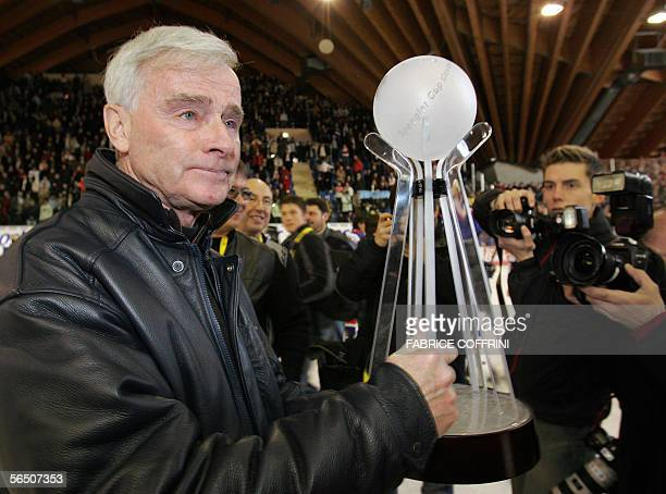 Canadian ice hockey legend and head coach of the Russian team HC Metallurg Magnitogorsk, Dave King hold the trophy 31 December 2005 after his team...