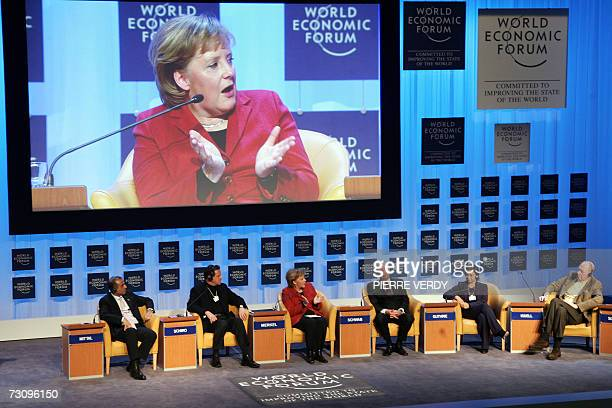 German Chancellor Angela Merkel talks during the opening plenary of the World Economic Forum 24 January 2007 The World business and political leaders...