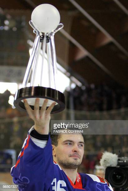 Russian HC Metallurg Magnitogorsk captain Evgeny Varlamov holds the trophy 31 December 2005 after his team won 8-3 over Team Canada at the final game...