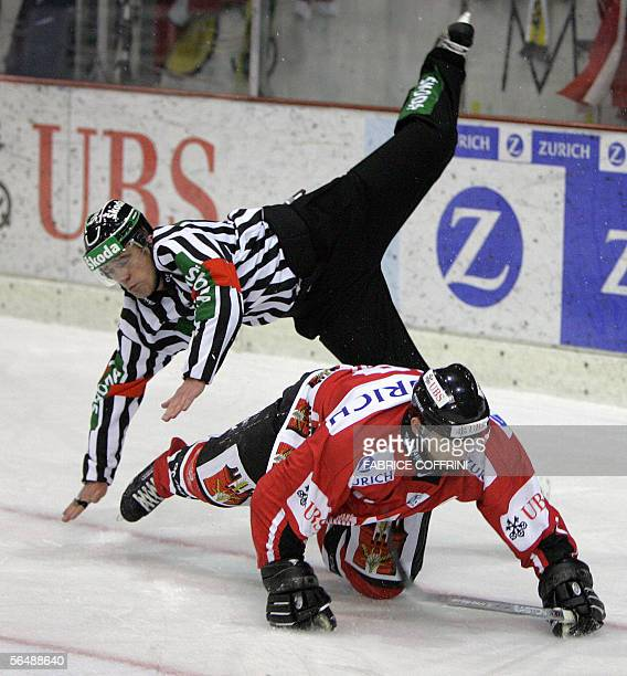 Team Canada's Stacy Roest crashes into referee Danny Kurmann during a penalty session that Team Canada lost against Russian HC Metallurg Magnitogorsk...