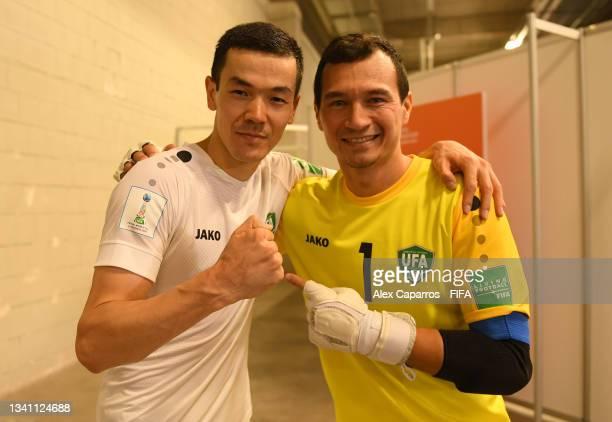 Davron Choriev of Uzbekistan and Rustam Umarov of Uzbekistan pose for a photo during the FIFA Futsal World Cup 2021 group B match between Egypt and...
