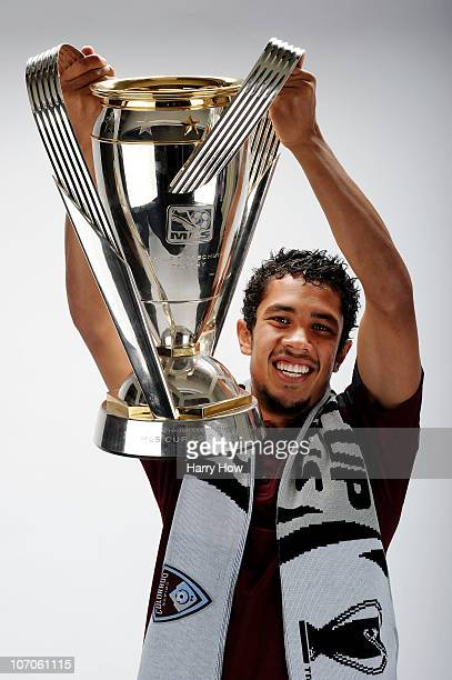 Davy Armstrong of the Colorado Rapids poses with the Philip F Anschutz MLS Cup trophy following the MLS Cup final at BMO Field on November 21 2010 in...