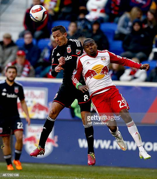 Davy Arnaud of DC United fights for the ball with Chris Duvall of New York Red Bulls during their match at Red Bull Arena on March 22 2015 in...
