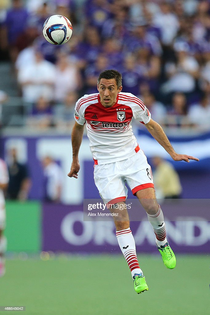 Davy Arnaud #8 of D.C. United heads the ball during a MLS soccer match between DC United and the Orlando City SC at the Orlando Citrus Bowl on April 3, 2015 in Orlando, Florida.