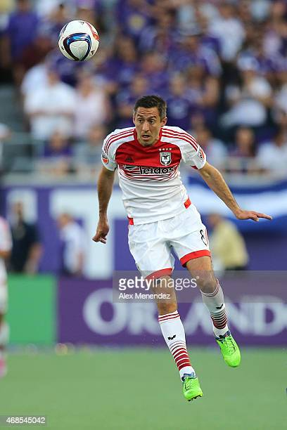 Davy Arnaud of DC United heads the ball during a MLS soccer match between DC United and the Orlando City SC at the Orlando Citrus Bowl on April 3...