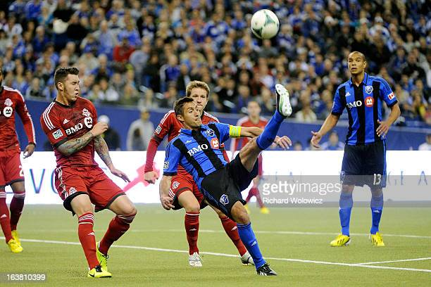 Davy Arnaud of Montreal Impact kicks the ball over his head during the MLS game against the Toronto FC at the Olympic Stadium on March 16 2013 in...