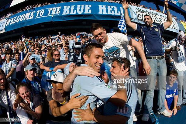 Davy Arnaud of Sporting Kansas City celebrates with fans a 2-0 win over New York Red Bulls at Livestrong Sporting Park on October 15, 2011 in Kansas...