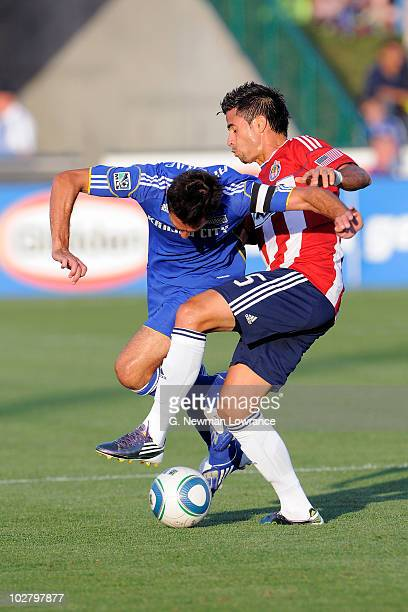 Davy Arnaud of the Kansas City Wizards is upended by Marcelo Saragosa of Chivas USA at CommunityAmerica Ballpark July 10 2010 in Kansas City Kansas