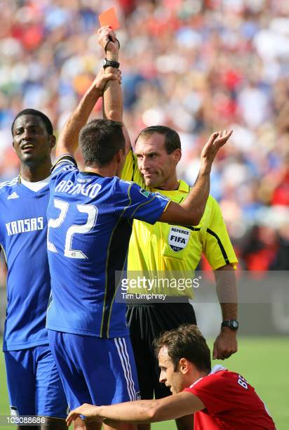 Davy Arnaud of the Kansas City Wizards pleads with referee Terry Vaughn after Jimmy Conrad received a red card during a friendly match against...