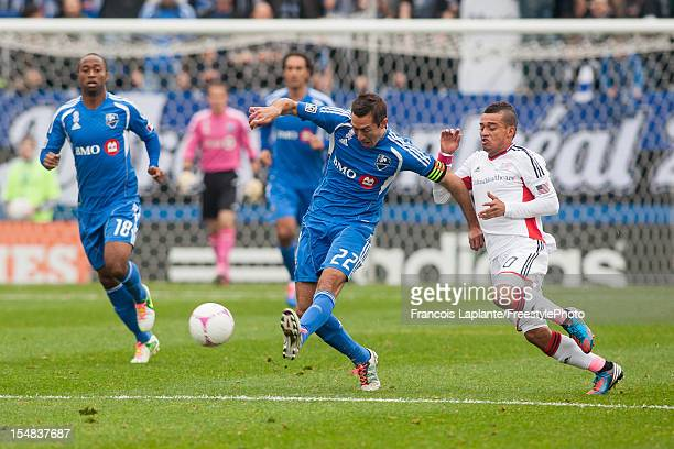 Davy Arnaud of the Montreal Impact controls the ball against Fernando Cardena of the New England Revolution during the MLS match at Saputo Stadium on...