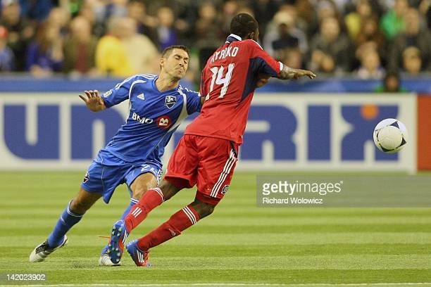 Davy Arnaud of the Montreal Impact defends against Patrick Nyarko of the Chicago Fire during the MLS match at the Olympic Stadium on March 17 2012 in...