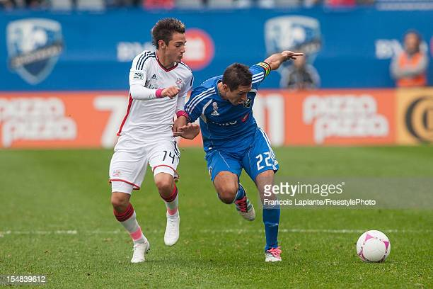 Davy Arnaud of the Montreal Impact protects the ball against Diego Fagundez during the MLS match at Saputo Stadium on October 27 2012 in Montreal...