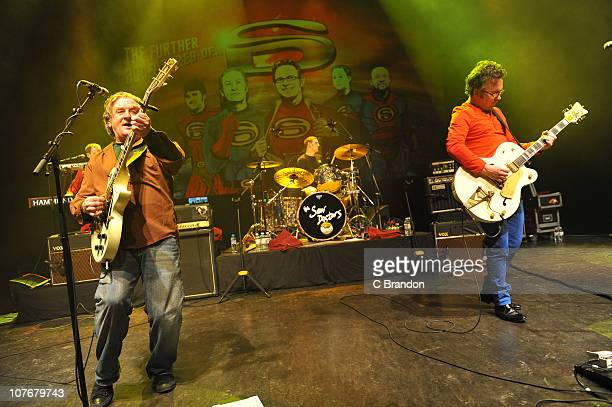 Davy Carton Eimhin Craddock and Leo Moran of The Saw Doctors perform on stage at Shepherds Bush Empire on December 18 2010 in London England