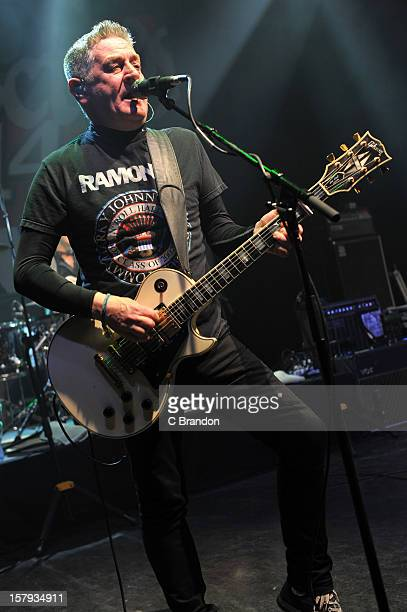 Davy Carton of The Saw Doctors performs on stage at O2 Shepherd's Bush Empire on December 7 2012 in London England