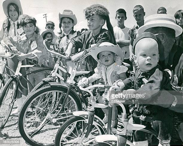 JUL 8 1967 JUL 12 1967 Davy CrockettAnnie Oakley Winners Line Up With New Bicycles Left to right are Beverly Smith and Lonny Saavedra 1214 division...