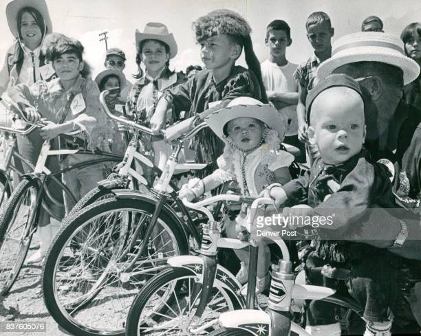 Davy CrockettAnnie Oakley Winners Line Up With New Bicycles Left to right are Beverly Smith and Lonny Saavedra 1214 division winners Gina...