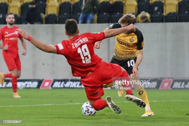 Davy Frick of FSV Zwickau and Patrick Weihrauch of SG Dynamo Dresden battle for the ball during the 3 Liga match between Dynamo Dresden and FSV...