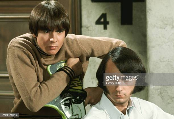 Davy Jones looks over Mike Nesmith's shoulder in a skit on The Monkees television show