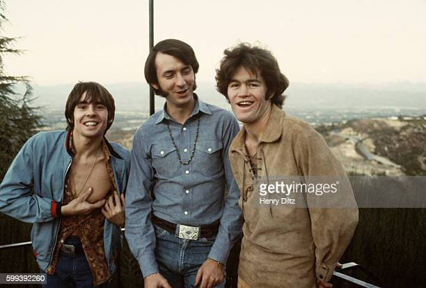 Davy Jones Mike Nesmith and Micky Dolenz of The Monkees goof off on a friend's deck overlooking the Hollywood Hills
