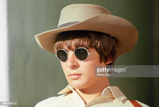 Davy Jones of The Monkees wears a cowboy hat and sunglass for a scene in the band's TV show