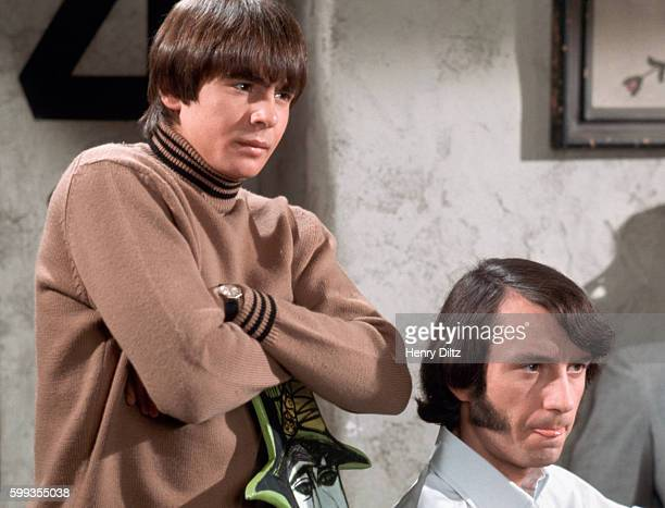 Davy Jones stands over Mike Nesmith in a skit on The Monkees television show