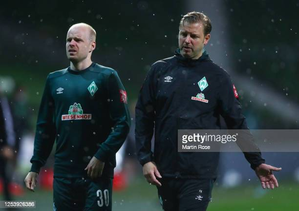 Davy Klaassen and Florian Kohfeldt, head coach of Bremen walk off dejected after the final whistle the Bundesliga playoff first leg match between...