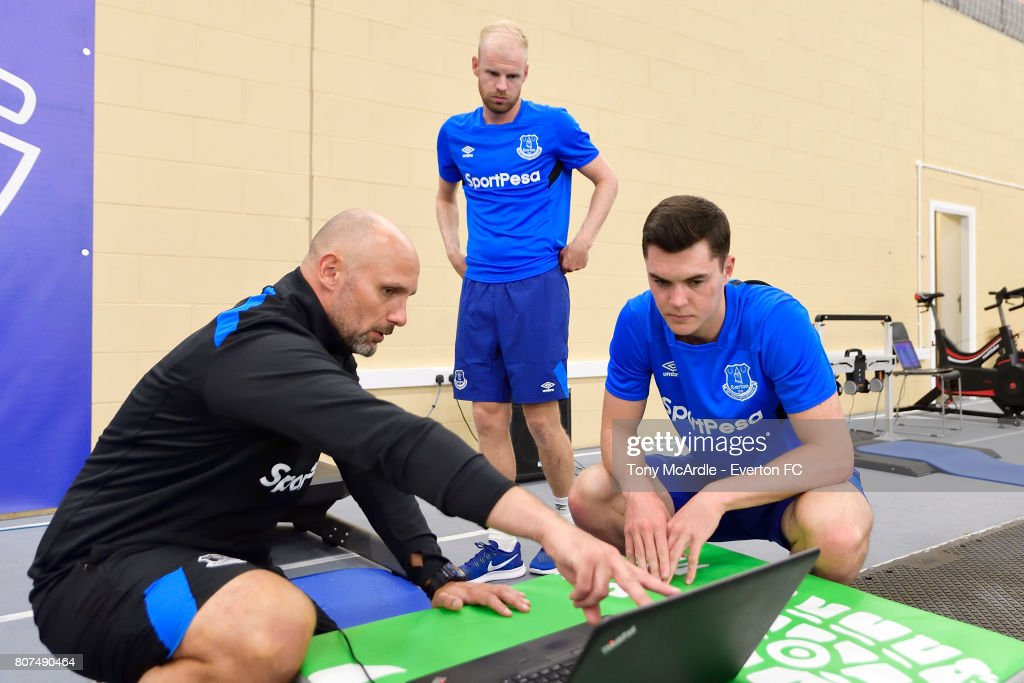 Davy Klaassen (C) and Michael Keane (R) of Everton during a pres season traiing session at USM Finch Farm on July 4, 2017 in Halewood, England.