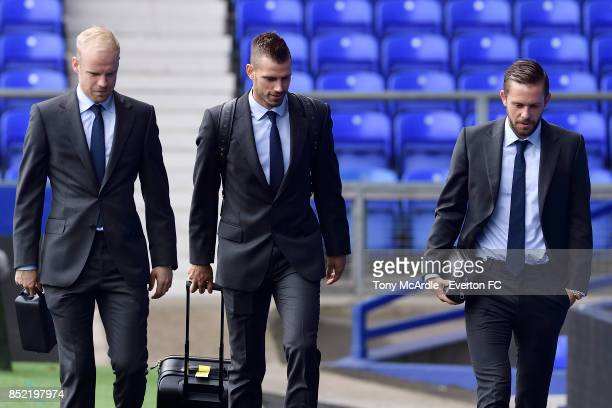 Davy Klaassen Morgan Schneiderlin and Gylfi Sigurdsson arrive before the Premier League match between Everton and AFC Bournemouth at Goodison Park on...