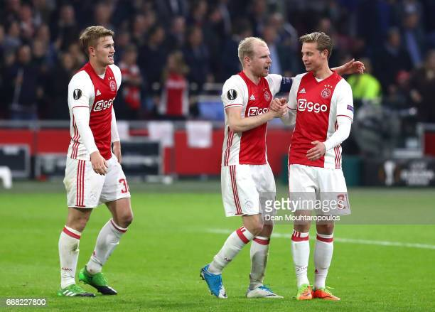 Davy Klaassen of Ajax and Frenkie de Jong of Ajax celebrate after the full time whistle during the UEFA Europa League quarter final first leg match...