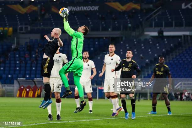 Davy Klaassen of Ajax and goalkeeper Pau Lopez of AS Roma during the UEFA Europa League Quarter Final: Leg Two match between AS Roma and Ajax at...