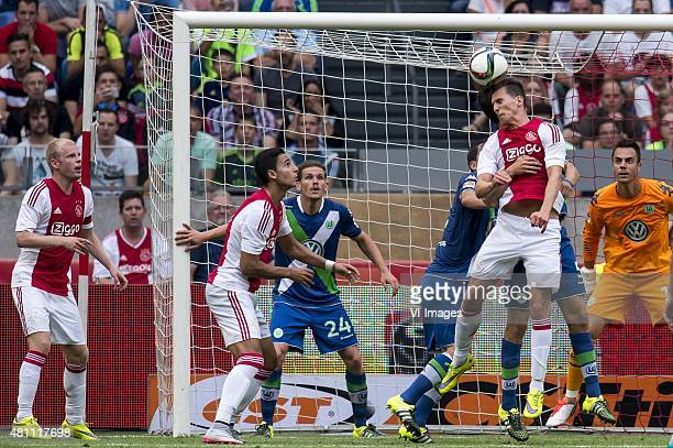 Davy Klaassen of Ajax Anwar el Ghazi of Ajax Sebastian Jung of VFL Wolfsburg Arek Milik of Ajax goalkeeper Diego Benaglio of VFL Wolfsburg during the...
