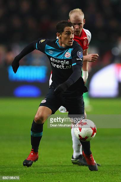 Davy Klaassen of Ajax battles for the ball with Andres Guardado of PSV during the Eredivisie match between Ajax Amsterdam and PSV Eindhoven held at...