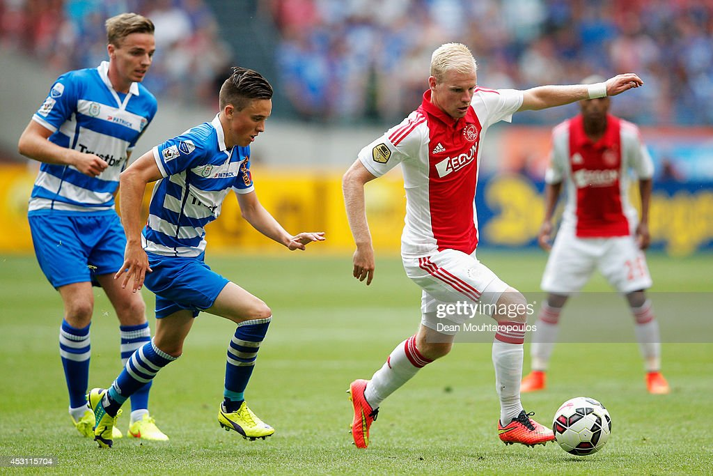 Davy Klaassen of Ajax gets past Ben Rienstra and Ryan Thomas of Zwolle during the 19th Johan Cruijff Shield match between Ajax Amsterdam and PEC Zwolle at the Amsterdam ArenA on August 3, 2014 in Amsterdam, Netherlands.