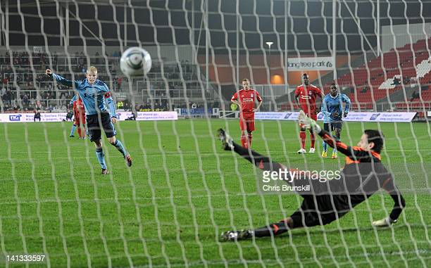 Davy Klaassen of Ajax scores his side's fourth goal from the penalty spot past Danny Ward of Liverpool during the NextGen Series Semi-Final match...