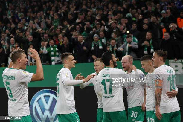 Davy Klaassen of Bremen celebrates his team's second goal with team mates during the DFB Cup quarterfinal match between FC Schalke 04 and Werder...