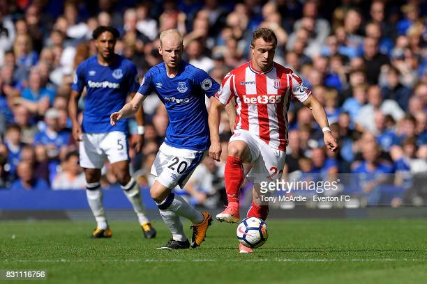 Davy Klaassen of Everton and Xherdan Shaqiri of Stoke City challenge for the ball during the Premier League match between Everton and Stoke City at...