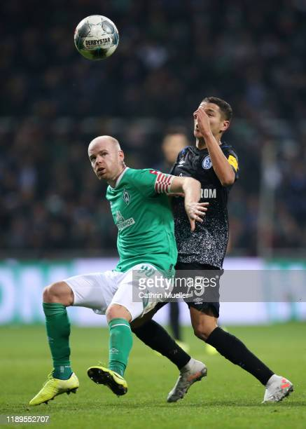 Davy Klaassen of SV Werder Bremen battles for possession with Amine Harit of FC Schalke 04 during the Bundesliga match between SV Werder Bremen and...