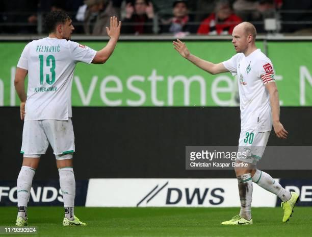 Davy Klaassen of SV Werder Bremen celebrates after scoring his team's first goal with teammate Milos Veljkovic of SV Werder Bremen during the...