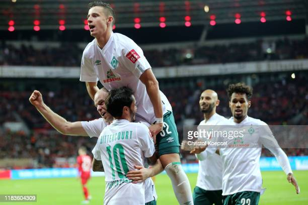 Davy Klaassen of SV Werder Bremen celebrates with teammates after scoring his team's second goal as Marco Friedl jumps on top during the Bundesliga...