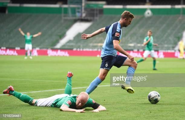 Davy Klaassen of SV Werder Bremen is brought down by Christoph Kramer of Borussia Moenchengladbach during the Bundesliga match between SV Werder...