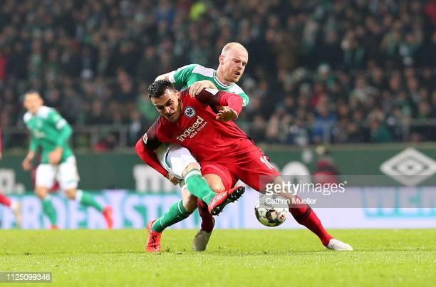 Davy Klaassen of Werder Bremen and Filip Kostic of Eintracht Frankfurt battle for the ball during the Bundesliga match between SV Werder Bremen and...