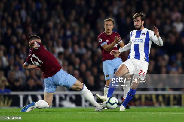 Davy Proepper of Brighton and Hove Albion is challanged by Declan Rice of West Ham United during the Premier League match between Brighton Hove...