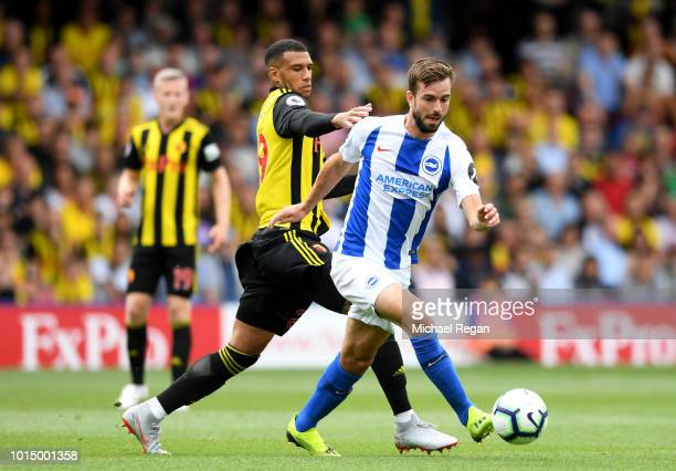 Davy Proepper of Brighton and Hove Albion is challenged by Etienne Capoue of Watford during the Premier League match between Watford FC and Brighton...