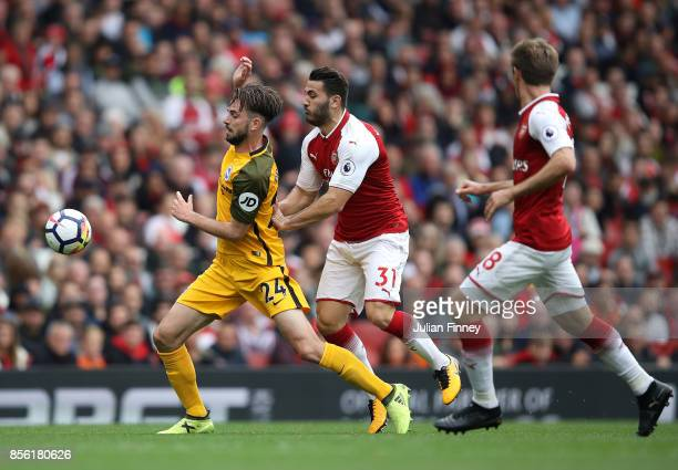 Davy Propper of Brighton and Hove Albion and Sead Kolasinac of Arsenal battle for possession during the Premier League match between Arsenal and...