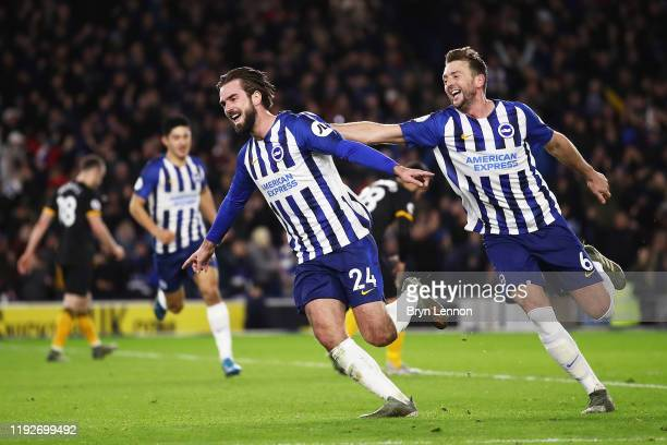 Davy Propper of Brighton and Hove Albion celebrates with teammate Dale Stephens after scoring his team's second goal during the Premier League match...