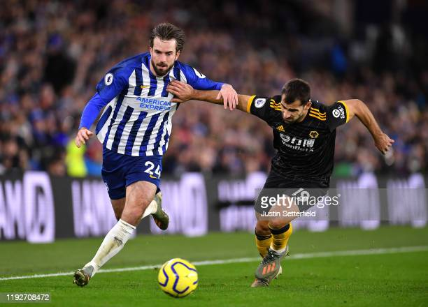 Davy Propper of Brighton and Hove Albion challenges for the ball with Jonny Otto of Wolverhampton Wanderers during the Premier League match between...