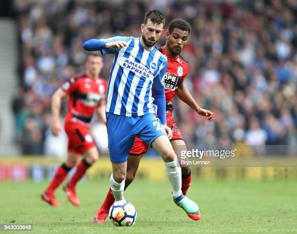 Davy Propper of Brighton and Hove Albion runs with the ball under pressure from Steve Mounie during the Premier League match between Brighton and...