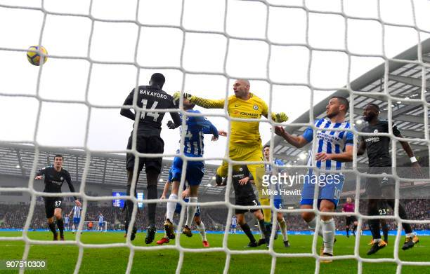 Davy Propper of Brighton and Hove Albion wins a header as Willy Caballero of Chelsea attempts to save during the Premier League match between...