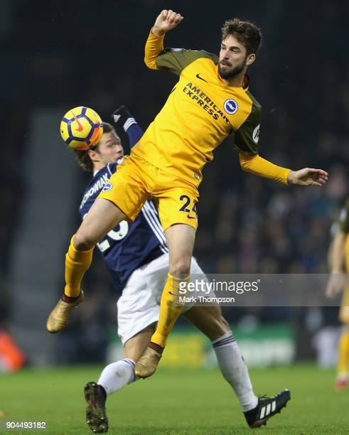 Davy Propper of Brighton and Hove Albion wins a header over Grzegorz Krychowiak of West Bromwich Albion during the Premier League match between West...