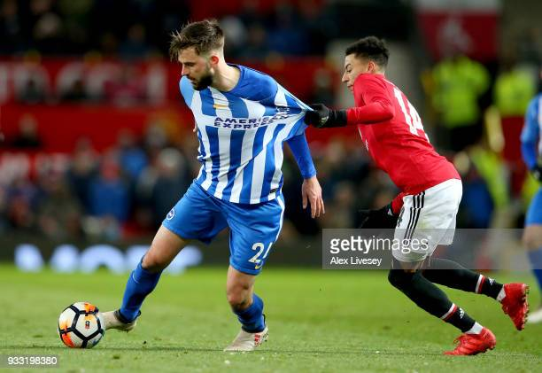 Davy Propper of Brighton is challenged by Anthony Martial of Manchester United during the Emirates FA Cup Quarter Final between Manchester United and...
